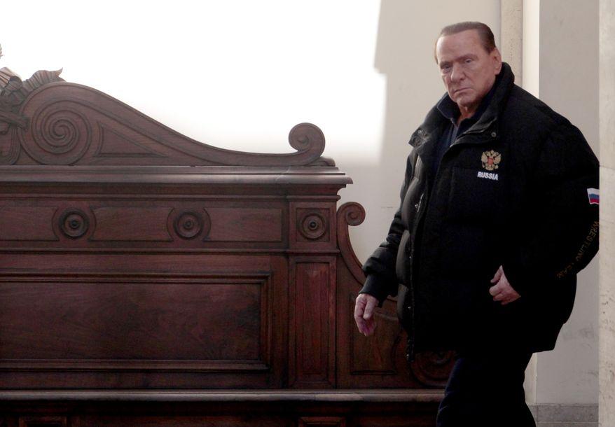 Former Italian Premier Silvio Berlusconi leaves his residence of Palazzo Grazioli in Rome, Saturday, Feb. 25, 2012. (AP Photo/Gregorio Borgia)