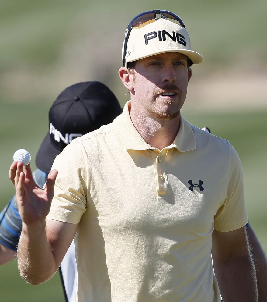 Hunter Mahan reacts after putting on the eighth hole while playing Matt Kuchar in the quarterfinal round during the Match Play Championship golf tournament, Saturday, Feb. 25, 2012, in Marana, Ariz. (AP Photo/Matt York)