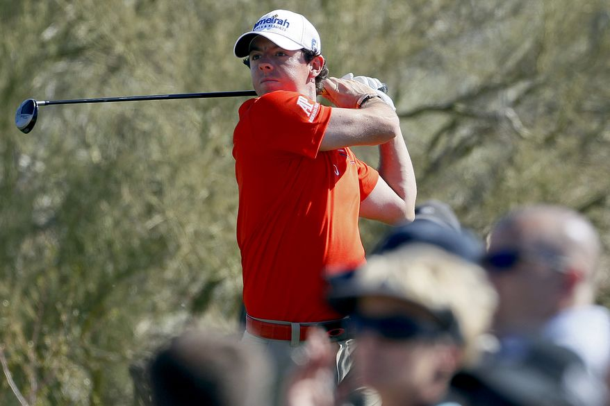 Northern Ireland's Rory McIlroy tees off on the 14th hole while playing South Korea's Bae Sang-moon during the Match Play Championship golf tournament, Saturday, Feb. 25, 2012, in Marana, Ariz. (AP Photo/Matt York)