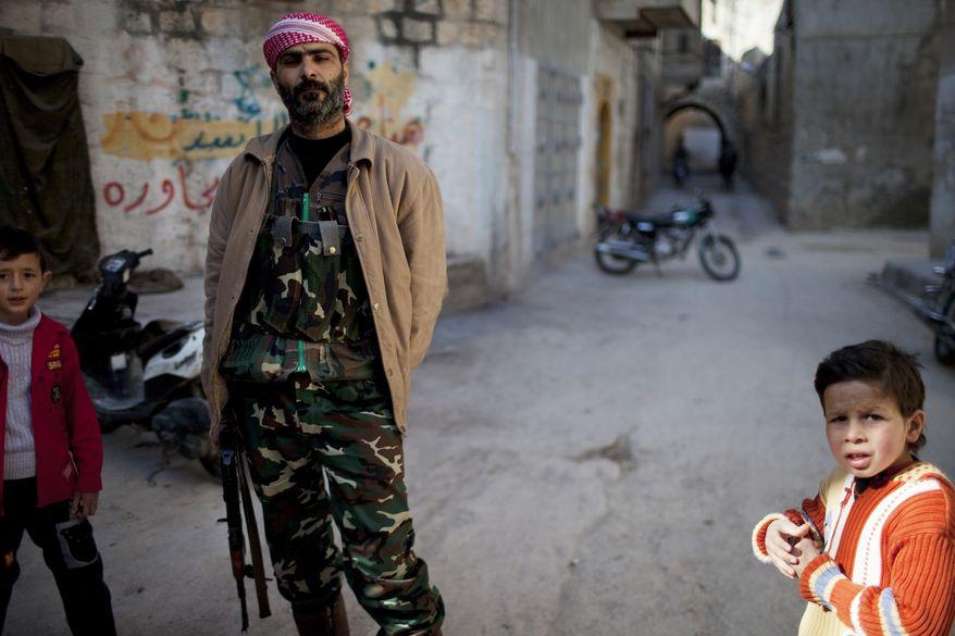 Supporters of the Free Syrian Army are seen in Kafar Taharim, Syria, Friday, Feb. 24, 2012. (AP Photo/Rodrigo Abd)