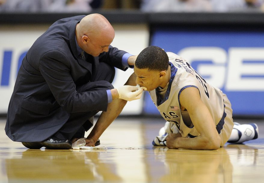 Georgetown forward Otto Porter is tended to after being hit in the mouth during the first half against Villanova, Saturday, Feb. 25, 2012, in Washington. Porter came back in the game and finished with 15 points. (AP Photo/Nick Wass)