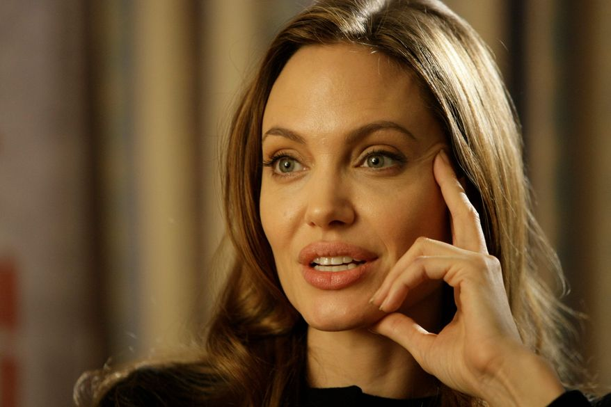 """Actress Angelina Jolie answers question during an interview with Associated Press, in Sarajevo, Bosnia, on Wednesday, Feb. 15, 2012. Angelina Jolie visited Bosnia for the premiere of her movie """"In the land of Blood and Honey"""". Angelina Jolie said Wednesday working as a director has rekindled her love for the film industry, even if it was something of a personal artistic rebellion. Jolie told The Associated Press in Sarajevo that she was starting to feel """"disheartened"""" and uninspired by her acting roles. She knew she wanted to use film as a medium to deal with weighty matters, such as human rights abuses. (AP Photo/Amel Emric)"""