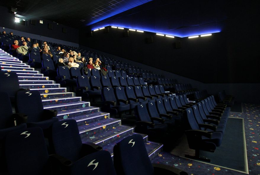 "A sparse gathering watches Angelina Jolie's ""In the Land of Blood and Honey"" on Friday in a theater in Belgrade, Serbia. The film has triggered mixed emotions in the postwar Balkans, garnering standing ovations in Sarajevo, Bosnia, but sparking outrage among Serbs, who claim it depicts them as the only villains of the 1992-95 war. (Associated Press)"