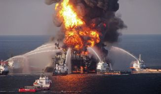 Fire boat response crews spray water on the burning remnants of BP's Deepwater Horizon offshore oil rig on Aprll 21, 2010.