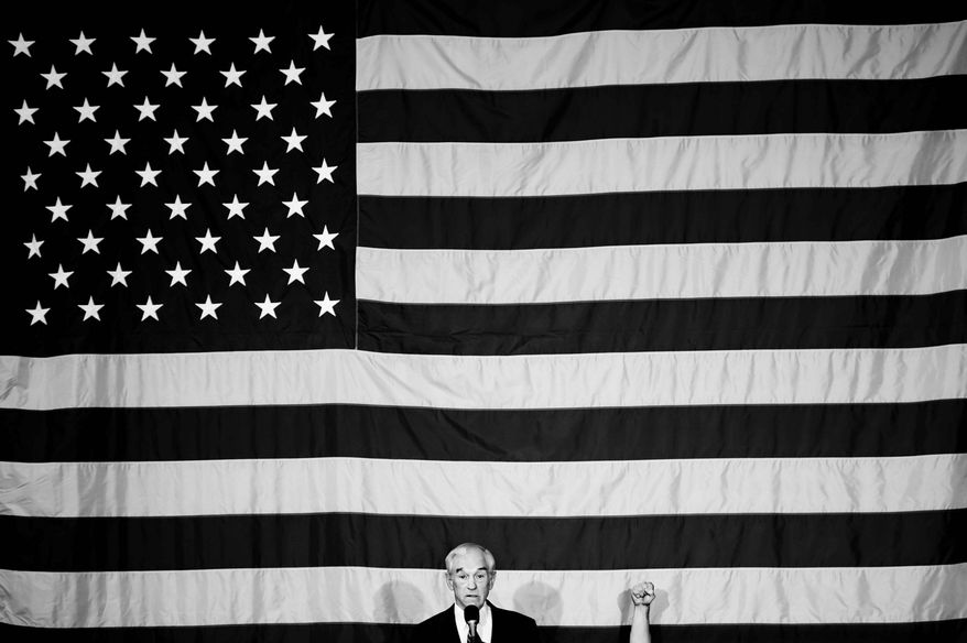 Washington Times photographer Andrew Harnik won first-place honors from the White House News Photographers Association for this photo of a fist raised at a Ron Paul rally in Iowa. (Andrew Harnik/The Washington Times)