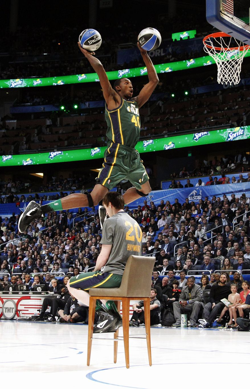 Utah Jazz's Jeremy Evans jumps over teammate Gordon Hayward for his attempt during the NBA basketball All-Star Slam Dunk Contest in Orlando, Fla., Saturday, Feb. 25, 2012. Evans earned 29 percent of 3 million text message votes cast by fans to win the competition. (AP Photo/Lynne Sladky)