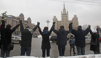 Russian protesters hold hands as part of a 10-mile-long human chain along the Garden Ring in Moscow during a demonstration against President Vladimir Putin on Sunday, Feb. 26, 2012. (AP Photo/Mikhail Metzel)
