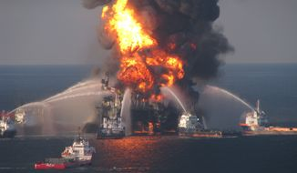 ** FILE ** Fire-boat response crews spray water on the burning remnants of BP's Deepwater Horizon offshore oil rig on April 21, 2010. (AP Photo/U.S. Coast Guard)