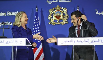 U.S. Secretary of State Hillary Rodham Clinton conducts a joint press conference with Moroccan Foreign Minister Saad Eddine Othmani in Rabat, Morocco, on Sunday, Feb. 26, 2012. (AP Photo/Jason Reed)