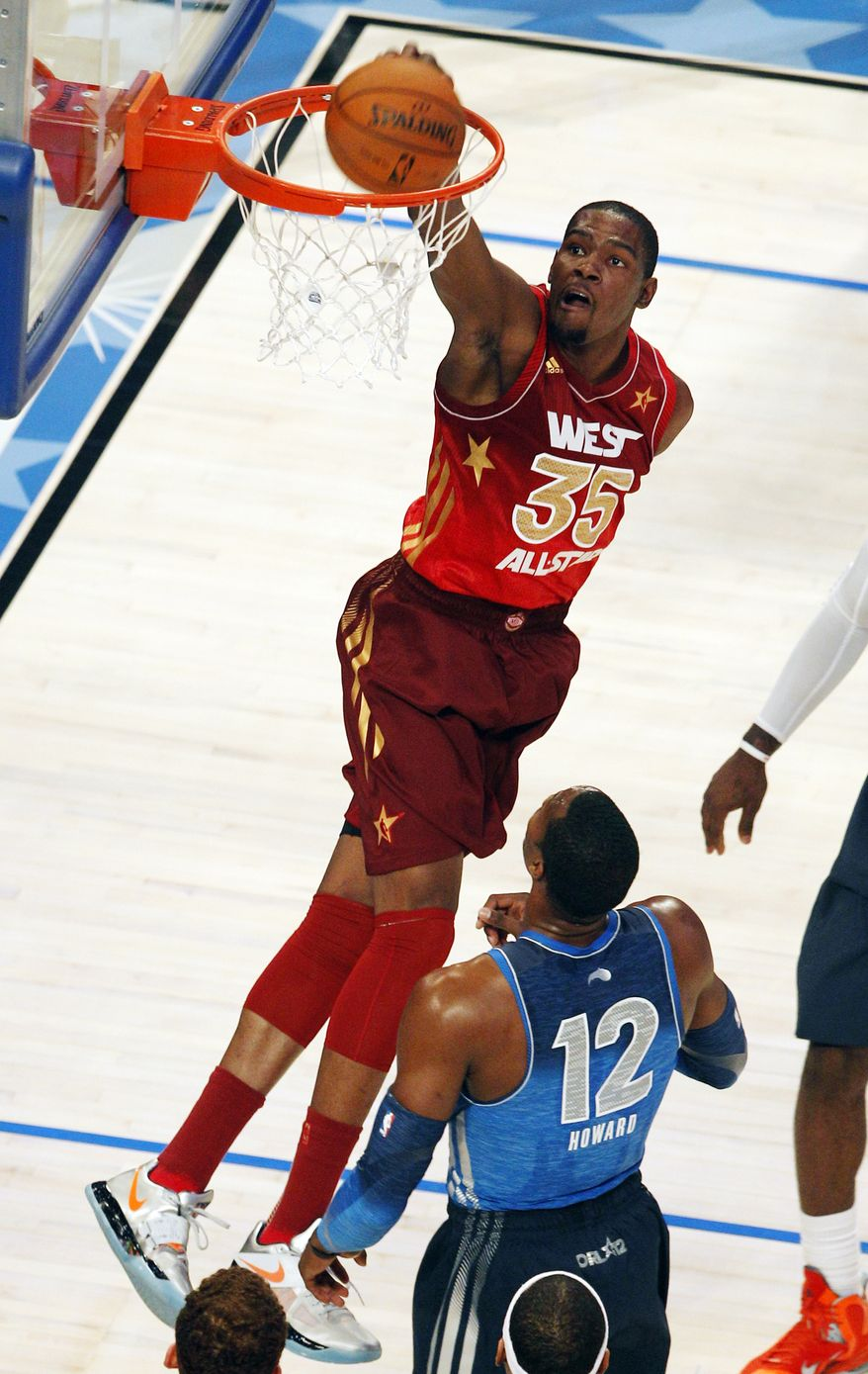 Western Conference's Kevin Durant (35), of the Oklahoma City Thunder, dunks over Eastern Conference's Dwight Howard (12), of the Orlando Magic, during the first half of the NBA All-Star Game, Sunday, Feb. 26, 2012, in Orlando, Fla. (AP Photo/Lynne Sladky)