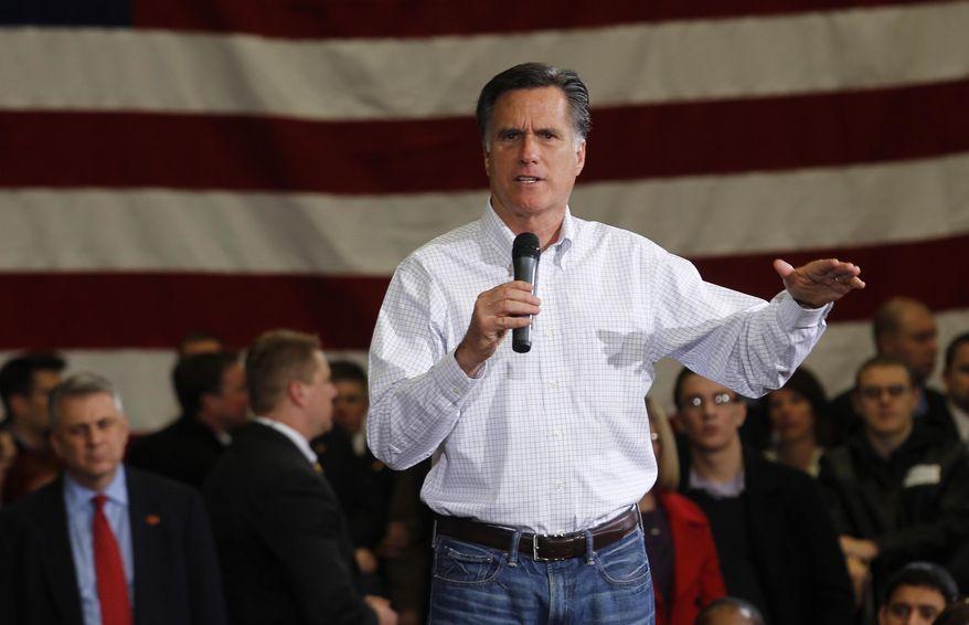 Former Massachusetts Gov. Mitt Romney speaks at a GOP presidential campaign rally in Flint, Mich., on Saturday, Feb. 25, 2012. (AP Photo/Gerald Herbert)
