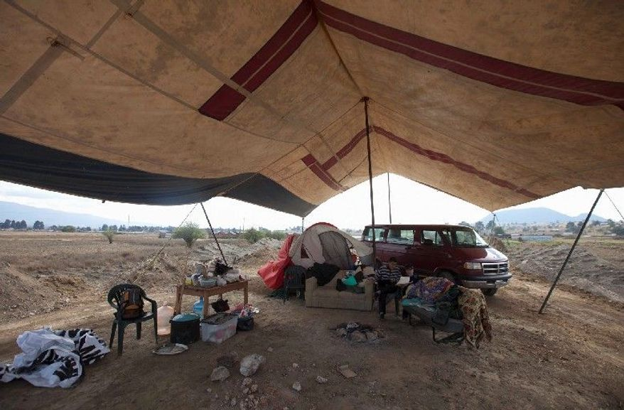 People camp in protest next to ruins on the outskirts of Amecameca, Mexico. The protesters have filed complaints with state and federal officials to demand that a highway under construction be rerouted after pre-Hispanic ruins were detected. (Associated Press)