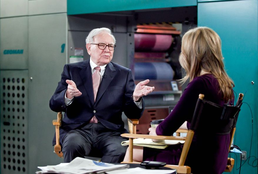 """Billionaire inverstor Warren Buffett chairman and CEO of Berkshire Hathaway, is interviewed by Becky Quick, co-host of CNBC's """"Squawk Box,"""" on the floor of the Omaha World-Herald's press room Monay Feb. 27, 2012, in Omaha Neb. Buffett said Monday that stocks remain relatively cheap compared to other investments as the economy continues to improve. He also said that the company he heads is prepared to replace him whenever the need arises. (AP Photo/The Omaha World-Herald, Jeff Beiermann)"""