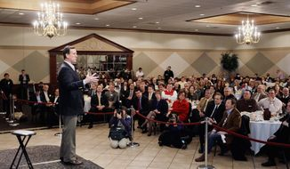 ASSOCIATED PRESS Republican presidential candidate Rick Santorum speaks at the Livonia Chamber of Commerce breakfast in Livonia, Mich., on Monday as he makes a pitch for votes the day before Michigan voters go to the polls.