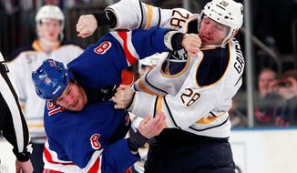 Center Paul Gaustad (right), tangling with the New York Rangers' Brandon Prust, will lend a helping hand - or fist - for Nashville, which acquired him from Buffalo. (Associated Press)