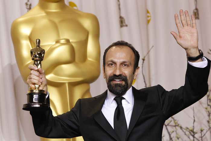 """Asghar Farhadi, of Iran, poses Feb. 26, 2012, with his award for best foreign language film for """"A Separation"""" during the 84th Academy Awards in Los Angeles. (Associated Press)"""