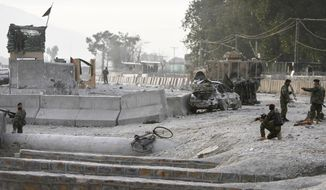 Afghan soldiers secure the scene of a suicide attack at the gate of an airport in Jalalabad, Afghanistan, on Monday, Feb. 27, 2012. (AP Photo/Rahmat Gul)