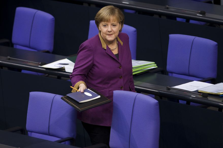 German Chancellor Angela Merkel arrives Feb. 27, 2012, in Berlin for her speech prior to the debate and the voting of the German Parliament Bundestag about a new Greek rescue package. (Associated Press)