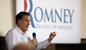 ** FILE ** Republican presidential candidate and former Massachusetts Gov. Mitt Romney speaks on Feb. 26, 2012, at a campaign rally in Traverse City, Mich. (Associated Press)