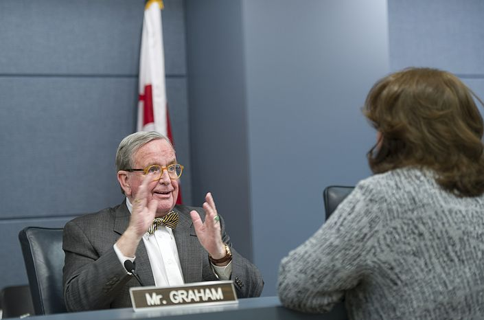 Councilman Jim Graham, chair of the Committee on Human Services, talks with Ellen London, president and CEO of the Children and Youth Investment Trust Corporation, before a performance oversight hearing on on Monday, Feb. 27, 2012 at the Wilson Building in Washington, D.C. Ms. London has been with the company for about 12 years but has only been president since June 2010 and said she was unable to testify about certain specific procedures relating to grant funding before then. (Barbara L. Salisbury/The Washington Times)