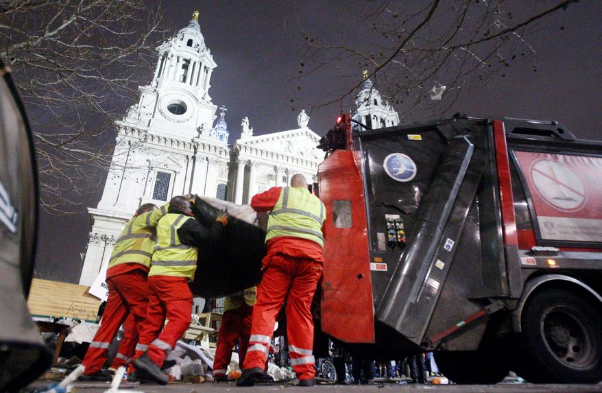 Police move in to clear out the Occupy London camp at St. Paul's Cathedral on Tuesday. Britain's High Court last Wednesday rejected the protesters' legal challenge to an eviction order. Local authorities claimed the camp had harmed nearby businesses, caused waste and hygiene problems, and attracted crime and disorder. (Associated Press)