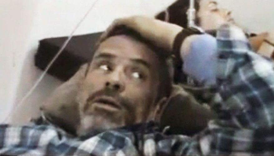 Paul Conroy of the Sunday Times lays wounded last week in a makeshift clinic in Homs, Syria. Activist groups say Mr. Conroy has been smuggled to safety in neighboring Lebanon by Syrian rebels. (Shaam News Network via Associated Press)