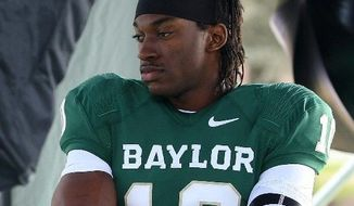 Baylor QB Robert Griffin III figures to go second overall in the coming NFL Draft, but which team will pay the price to acquire the St. Louis Rams' pick? (Associated Press)