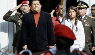 Venezuelan President Hugo Chavez (front left), accompanied by daughter Rosines, appears outside Miraflores presidential palace Friday in Caracas. His most recent cancer surgery was a success, his vice president, Elias Jaua, said Tuesday. He said a pelvic lesion and surrounding tissue were removed. (Associated Press)