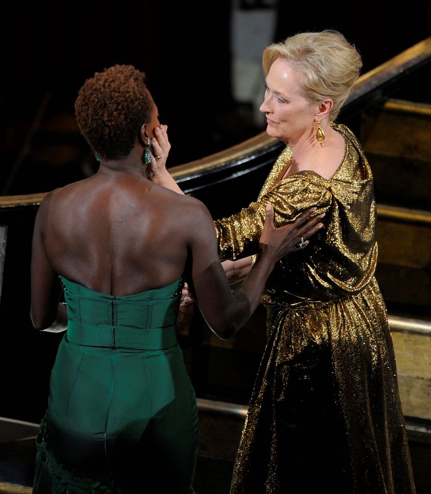 "Viola Davis (left) congratulates Meryl Streep as Miss Streep goes up to accept the Oscar for best actress Sunday for ""The Iron Lady"" at the Academy Awards. Miss Davis was also nominated, for ""The Help."" (Associated Press)"