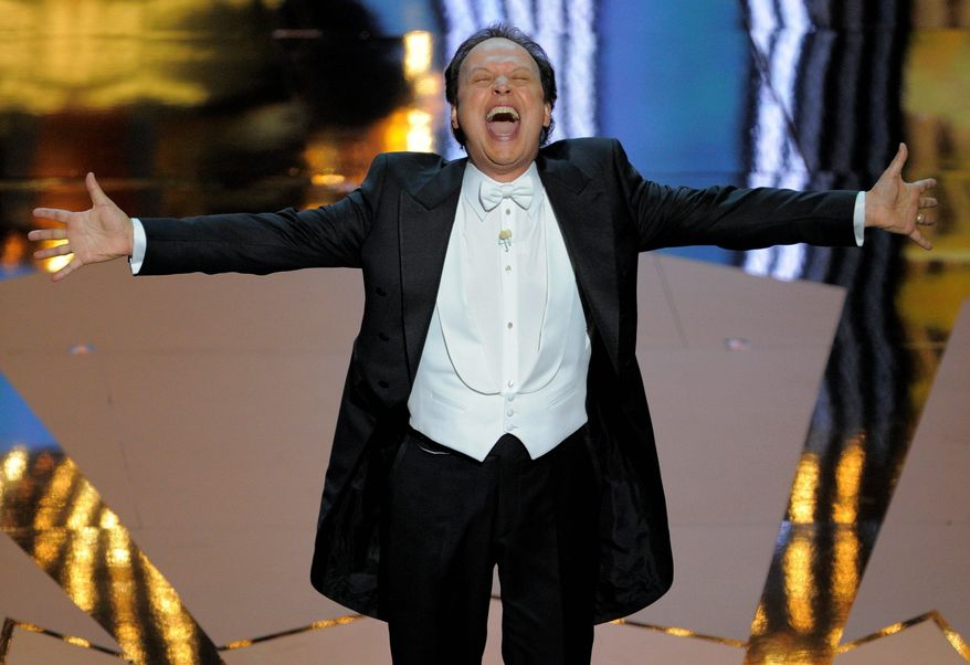 """Critics panned Billy Crystal's hosting and the rest of Sunday's Academy Awards show, but ratings 4 percent higher than last year's indicate viewers didn't miss the """"edge"""" critics wanted. (Associated Press)"""