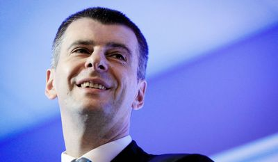 Mikhail Prokhorov, a majority owner of the NBA's New Jersey Nets, is one of Russian Prime Minister Vladimir Putin's three main foes in Sunday's presidential election. (Associated Press)