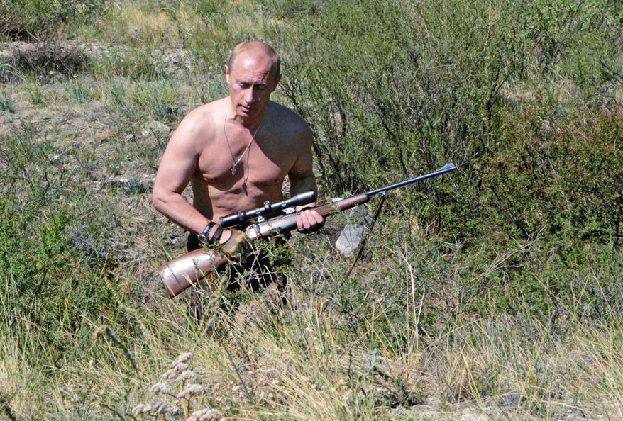 ** FILE ** Vladimir Putin stalks the Tuva region of Siberia in this photo from August 2007. (Associated Press)