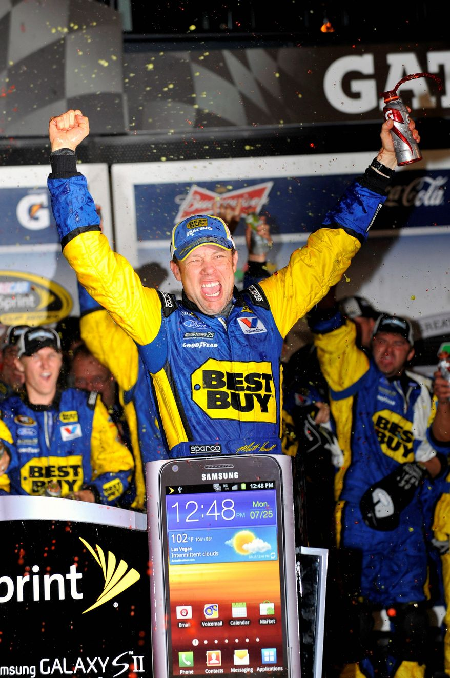 Matt Kenseth celebrates his second Daytona 500 victory, which came in the early hours of Tuesday. The race was postponed from Sunday. (Associated Press)