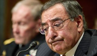 **FILE** Defense Secretary Leon E. Panetta (right), accompanied by Army Gen. Martin E. Dempsey, chairman of the Joint Chiefs of Staff, testifies on Capitol Hill in Washington on Feb. 28, 2012, before the Senate Budget Committee on the Pentagon's fiscal 2013 budget. (Associated Press)