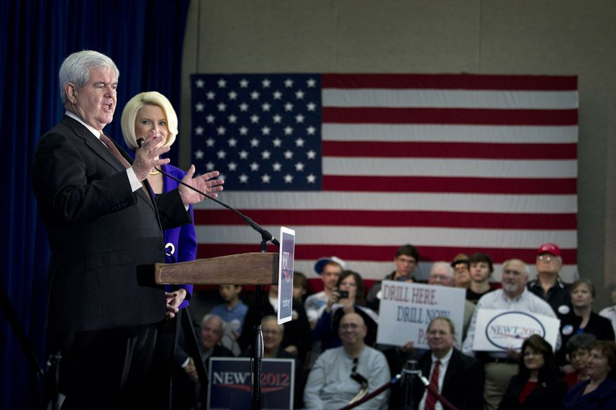 Former House Speaker Newt Gingrich, accompanied by wife Callista, campaigns for the Republican presidential nomination in Dalton, Ga., on Tuesday, Feb. 28, 2012. (AP Photo/Evan Vucci)