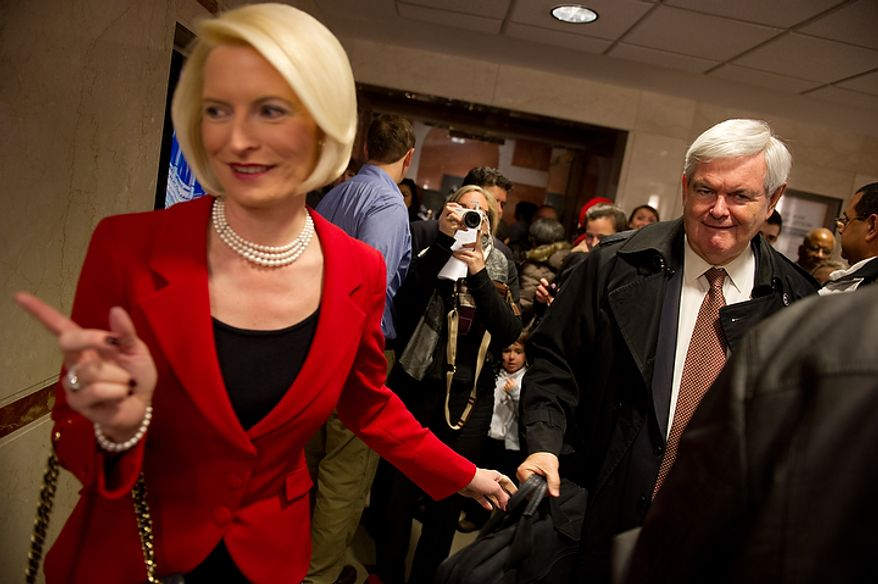 Former House Speaker Newt Gingrich and his wife, Callista, depart after a Christmas Mass celebrated by Cardinal Donald Wuerl, archbishop of Washington, at the Basilica of the National Shrine of the Immaculate Conception on Sunday, Dec. 25, 2011, in Washington. (Andrew Harnik/The Washington Times)
