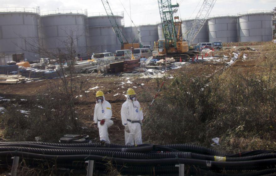 Water tanks are pictured at Tokyo Electric Power Co.'s tsunami-crippled Fukushima Dai-ichi nuclear power station in Okuma, Fukushima prefecture, in northeastern Japan, on Tuesday, Feb. 28, 2012. (AP Photo/Kimimasa Mayama, Pool)