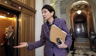 ** FILE ** In this Dec. 17, 2011, file photo, Sen. Olympia Snowe, Maine Republican, comments in the U.S. Capitol in Washington, after leaving the floor of the Senate. Snowe, who has served 33 years in Congress, released a statement Tuesday, Feb. 28, 2012 saying that she will not run for re-election. (AP Photo/J. Scott Applewhite, File)