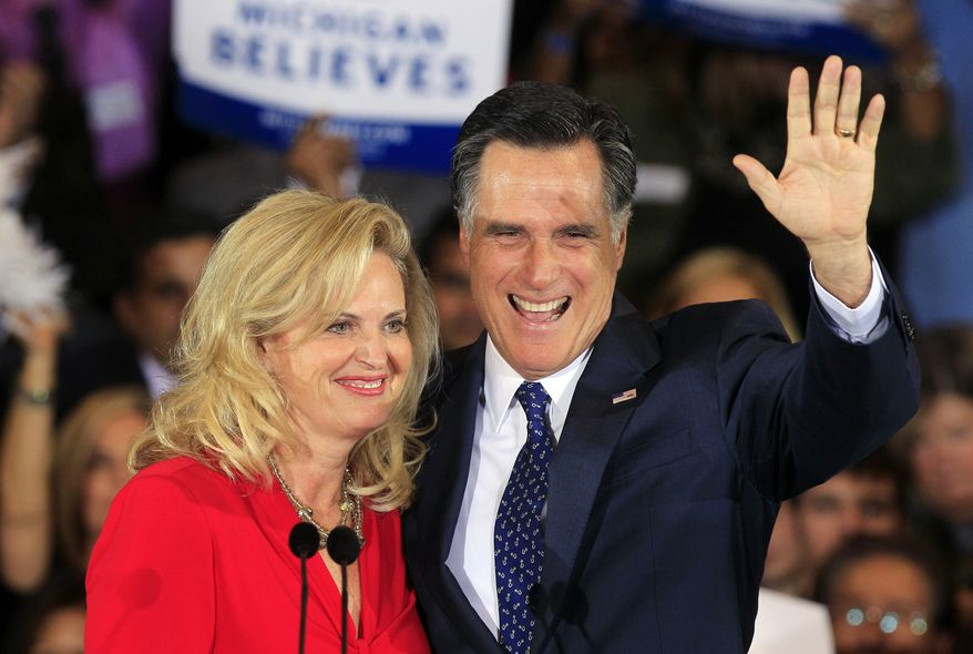 Republican presidential candidate, former Massachusetts Gov. Mitt Romney and his wife Ann Romney wave at his election night party in Novi, Mich., Tuesday, Feb. 28, 2012. (AP Photo/Carlos Osorio)