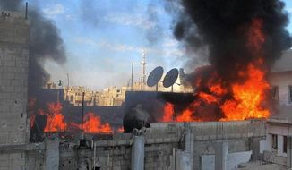 Flames rise from a house in the Baba Amr neighborhood in Homs province after Syrian government shelling. A photojournalist and a war correspondent were killed last week as Syrian forces intensely shelled Homs. (Associated Press)