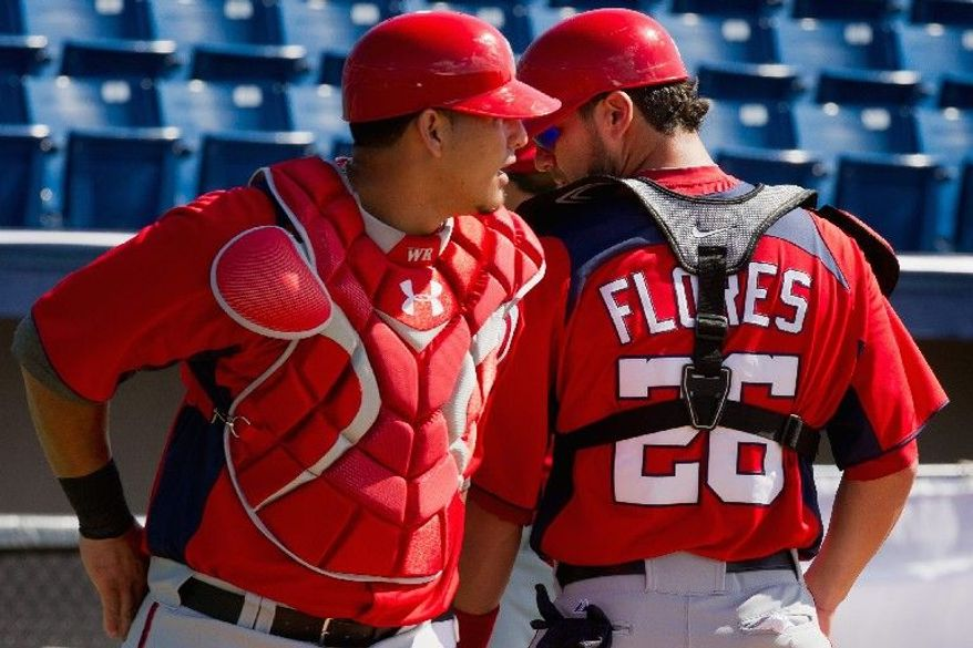 """Washington Nationals catcher Jesus Flores lost his starting job to Wilson Ramos when a shoulder injury took him away from the game for two years. This spring, after playing winter ball in his native Venezuela, Flores is showing his old form. """"Even though I was playing [last year], I never felt I was losing the fear of throwing and doing too much stuff without worrying about my shoulder,"""" he says. """"This year is totally different."""" (Andrew Harnik/The Washington Times)"""