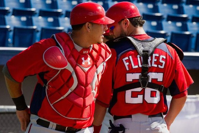 "Washington Nationals catcher Jesus Flores (26) poses for a portrait during photo day at spring training, Viera, Fla., Tuesday, Feb. 28, 2012. (Andrew Harnik/The Washington Times)ANDREW HARNIK/THE WASHINGTON TIMES  Washington Nationals catcher Jesus Flores lost his starting job to Wilson Ramos when a shoulder injury took him away from the game for two years. This spring, after playing winter ball in his native Venezuela, Flores is showing his old form. ""Even though I was playing [last year], I never felt I was losing the fear of throwing and doing too much stuff without worrying about my shoulder,"" he says. ""This year is totally different."""