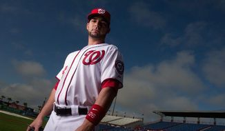 Washington Nationals catcher Jesus Flores (26) poses for a portrait during photo day at spring training, Viera, Fla., Tuesday, Feb. 28, 2012. (Andrew Harnik/The Washington Times)
