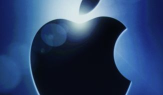 **FILE** The Apple logo is seen  Oct. 4, 2011, during an announcement at Apple headquarters in Cupertino, Calif. (Associated Press)