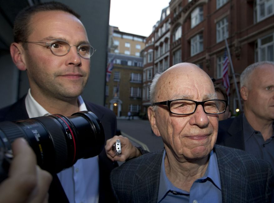 **FILE** Rupert Murdoch (right), Chairman of News Corporation, and his son James Murdoch, chief executive of News Corporation Europe and Asia, arrive July 10, 2011 at Rupert Murdoch's residence in central London. (Associated Press)