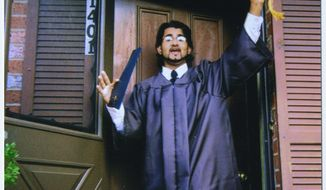 **FILE** In this 1999 file family photo provided by the Center for Constitutional Rights, Majid Khan gestures during his senior year of high school in Baltimore. The former Maryland resident is accused of joining al Qaeda and plotting to blow up fuel tanks in the U.S. (Associated Press/The Khan Family, Center for Constitutional Rights)