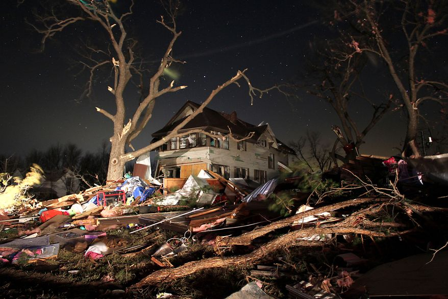 Damage from an apparent tornado is pictured early on Wednesday, Feb. 29, 2012, in Harveyville, Kan. (AP Photo/Matthew Fowler, Gazette)