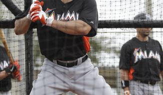 Miami Marlins' Mike Stanton takes batting practice during a spring training workout Sunday, Feb. 26, 2012, in Jupiter, Fla. (AP Photo/Jeff Roberson)
