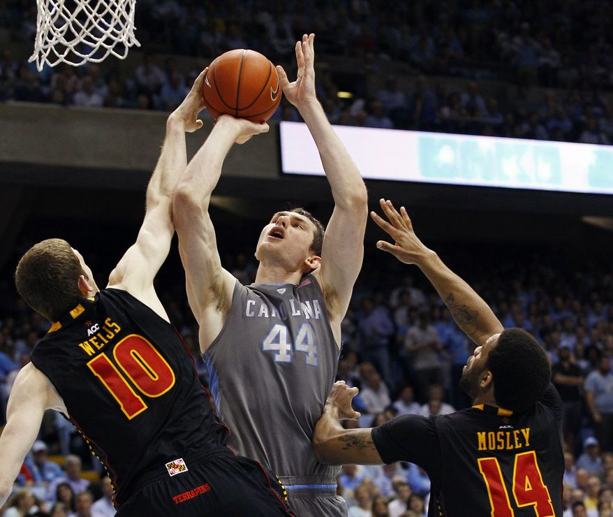 North Carolina's Tyler Zeller shoots while Maryland's Berend Weijs and Sean Mosley defend during the second half  in Chapel Hill, N.C., Wednesday, Feb. 29, 2012. North Carolina won 88-64. (AP Photo/Gerry Broome)