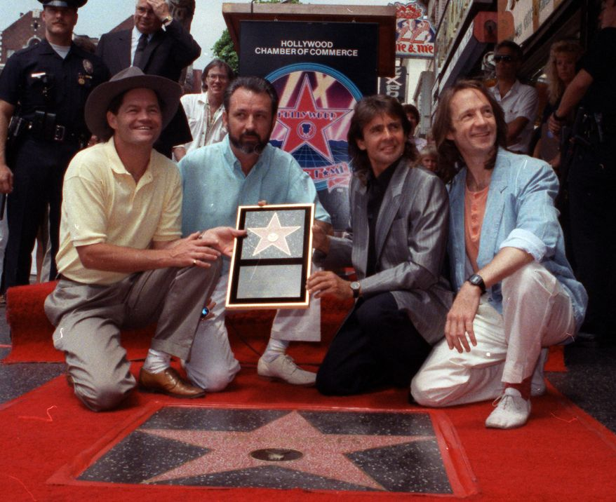 **FILE** The Monkees' (from left) Micky Dolenz, Mike Nesmith, Davy Jones and Peter Tork get a star on the Hollywood Walk of Fame in Los Angeles on July 10, 1989. Jones died Feb. 29, 2012, in Florida. He was 66. (Associated Press)